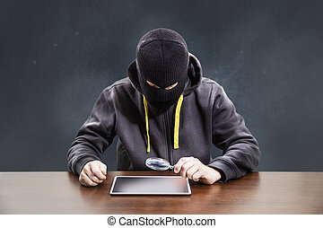 Thief hacking tablet mobile security
