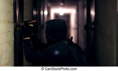 Thief hacking the lock in the basement