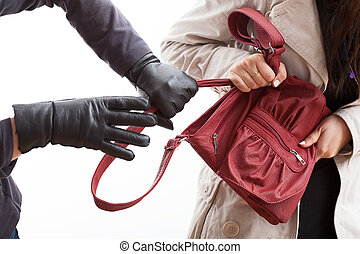 Thief holding a bag - A closeup of a thief wearing gloves...