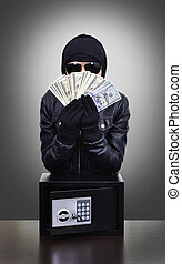 Thief holding dollars