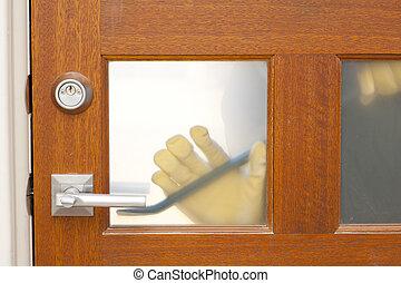 Thief housebreaking security door crowbar - Hands of...
