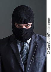 Thief in black mask and in office suit over grey