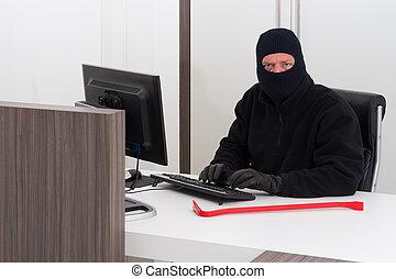Thief stealing company info - A burglar is robbing knowledge...