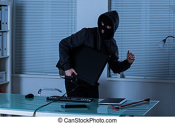 Thief Stealing Computer From Office