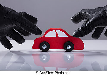 Thief Stealing Red Car