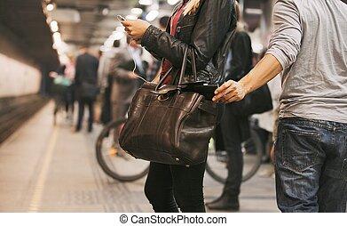 Thief stealing wallet at the subway station - Young woman ...