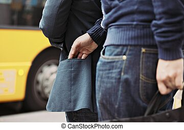 Pickpocketing on the street during daytime - Thief stealing...