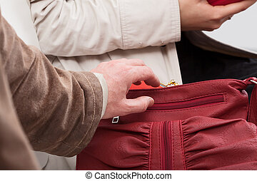Thief trying to steal a wallet - Thief trying to take out...