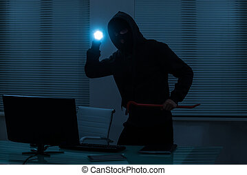 Thief With Flashlight In Office