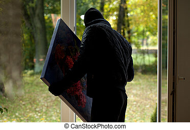 Thief with painting - A thief holding a precious stolen...