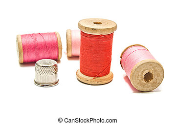 thimble and spools of thread