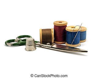 thimble, needle, scissors and threads