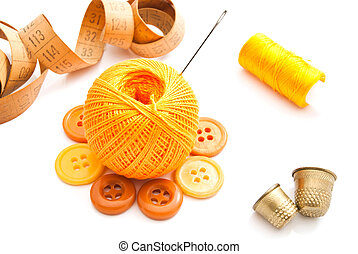 thimble, spools of thread and meter