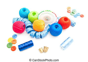 thimbles and other items for needlework on white