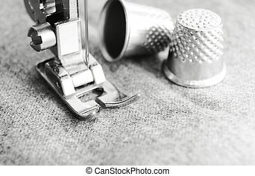 Thimbles and sewing machine. - Thimbles and the sewing...