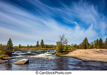 Thin cirrus clouds - Foam water rapids on the smooth stones...