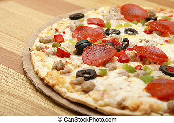 A fresh thin crust pizza sitting on the counter.