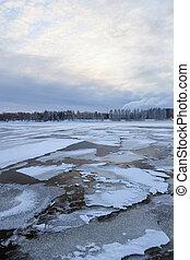 Thin ice on a lake at sunrise
