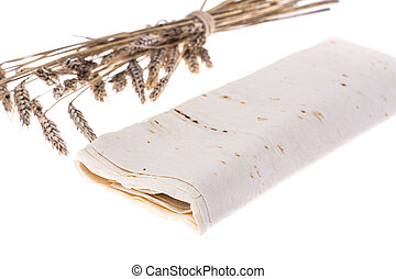 Thin lavash, rolled up, on white background