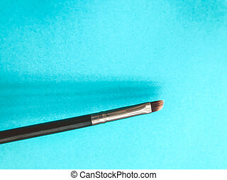thin makeup brush. makeup brush with natural brown bristles. eye paint, eyebrow shaping. creating a new image. makeup artist tool. beautiful eyes and lips. makeup lines.