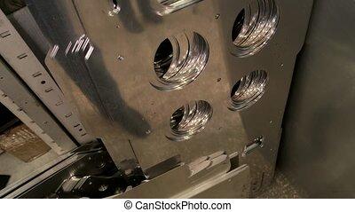 Thin metal parts on shelf. New steel details closeup....