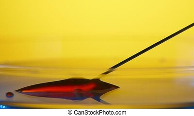 Thin needle takes in red blood from a glassy area in a medical laboratory