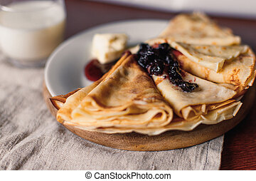 Thin pancakes for breakfast. Russian bliny. Maslenitsa