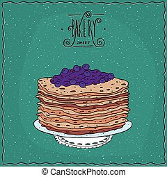 Thin pancakes with blue berries on lacy napkin