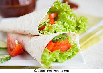 thin pita bread with lettuce and tomato, closeup