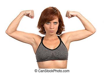 Thin Redhead Woman Flexing Muscles
