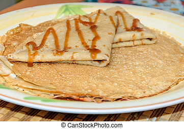 Thin russian pancakes on the plate. Maslenitsa is coming