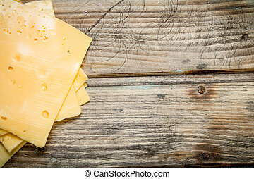 Thin slices of cheese.