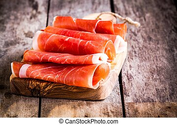 thin slices of prosciutto on a cutting board