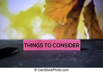 Things to Consider on the sticky notes with bokeh background