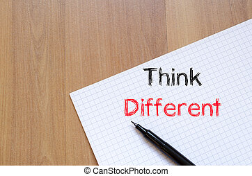 Think different text concept on notebook