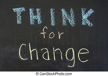 Think for change concept, words on blackboard