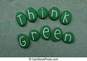 Think green, ecology and green energy concepts text with green colored stones over green sand