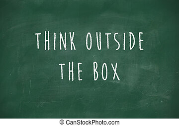 Think outside the box handwritten on blackboard