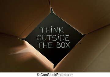 Think outside the box on blackboard - Concept image about...