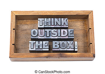 think outside the box phrase made from metallic font type in wooden box