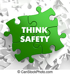 Think Safety on Green Puzzle on White Background.