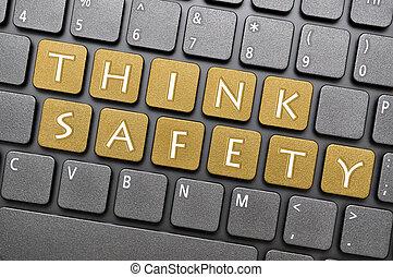 Think safety on keyboard - Golden think safety key on...