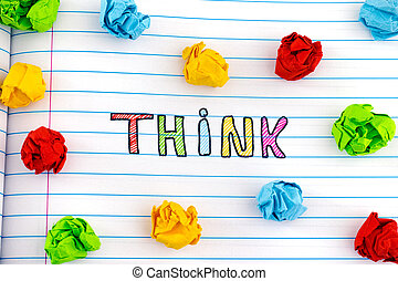 The word Think on notebook sheet with some colorful crumpled paper balls around it