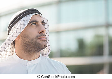 Thinking about new business ideas. Portrait of thoughtful Arab businessman looking away