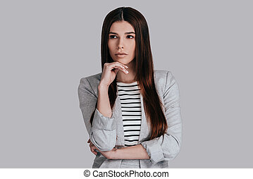 Thinking about solutions. Attractive young woman in smart...