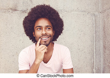 Thinking african american hipster man
