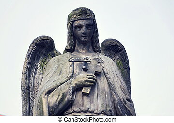 Thinking angel with cross statue, Malostransky cemetery,...