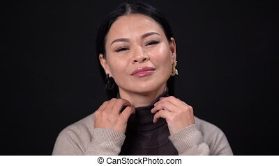 Thinking asian businesswoman on dark background - Thinking...
