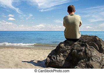 Thinking at beach - Alone man thinking at the beach