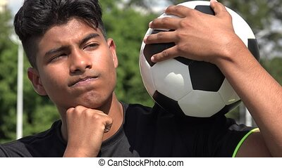 Thinking Athletic Teen Male Soccer Player